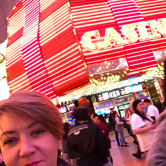 Corinne infront of the Casino sign in Vegas