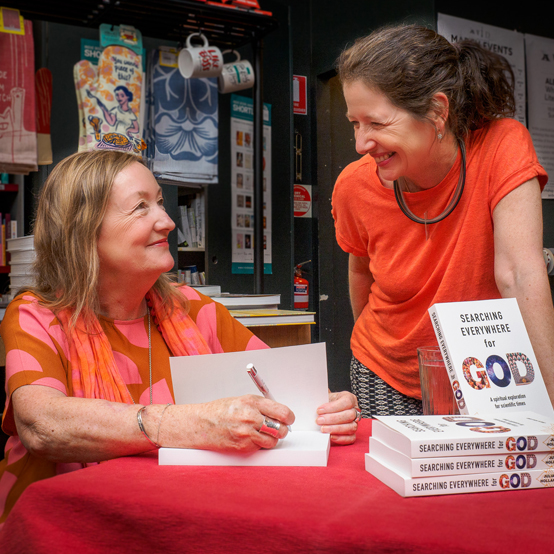 Julia signing copies of her book Searching Everywhere for God