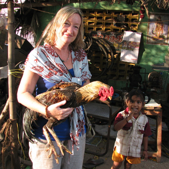 Julia holding a prize chook in India