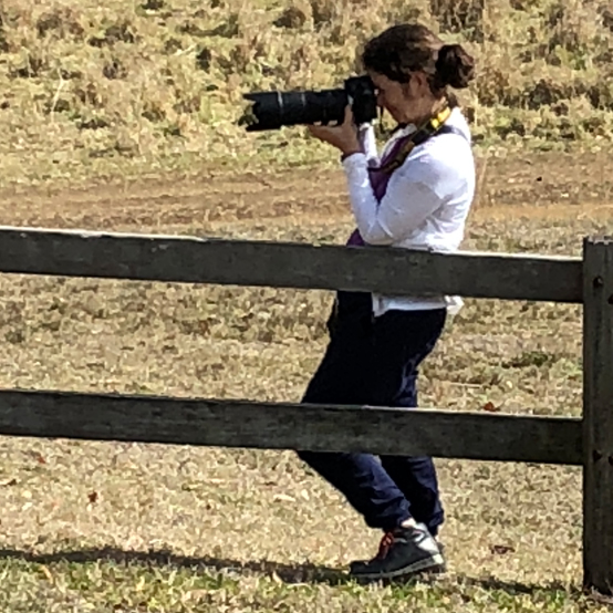 Nicki Lloyd with camera on a station in the South Burnett