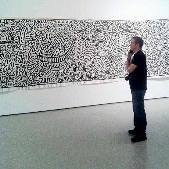 Tim Grey looking at a Keith Haring artwork in MoMA, New York
